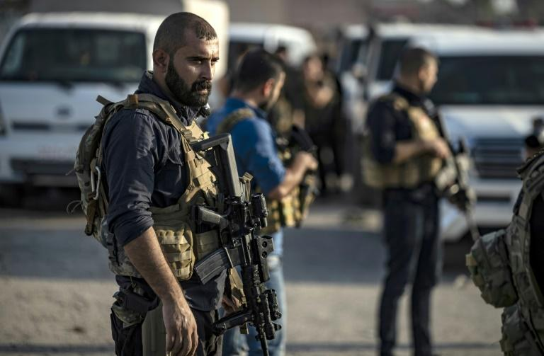 Members of the special forces of the Kurdish-led Syrian Democratic Forces (SDF) prepare to join the fight against Turkey