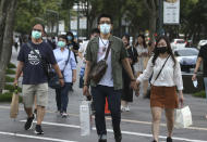 People wear face masks to protect against the spread of the coronavirus in Taipei, Taiwan, Saturday, May 30, 2020. (AP Photo/Chiang Ying-ying)