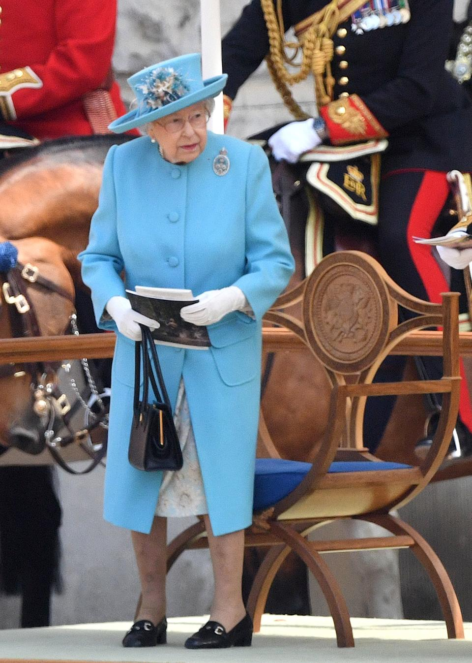 The Queen stood out in a sky blue coat and floral dress by Stewart Parvin and a matching hat by Angela Kelly. (PA Images)