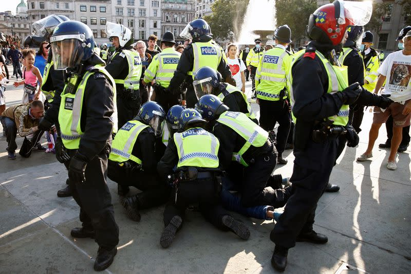 Police clash with protesters at anti-lockdown demonstration in London