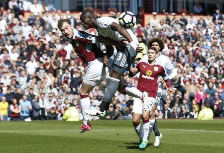 Britain Football Soccer - Burnley v Manchester United - Premier League - Turf Moor - 23/4/17 Manchester United's Eric Bailly in action with Burnley's Ashley Barnes Reuters / Andrew Yates Livepic