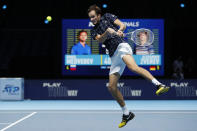 Daniil Medvedev of Russia plays a return to Alexander Zverev of Germany during their singles tennis match at the ATP World Finals tennis tournament at the O2 arena in London, Monday, Nov. 16, 2020. (AP Photo/Frank Augstein)