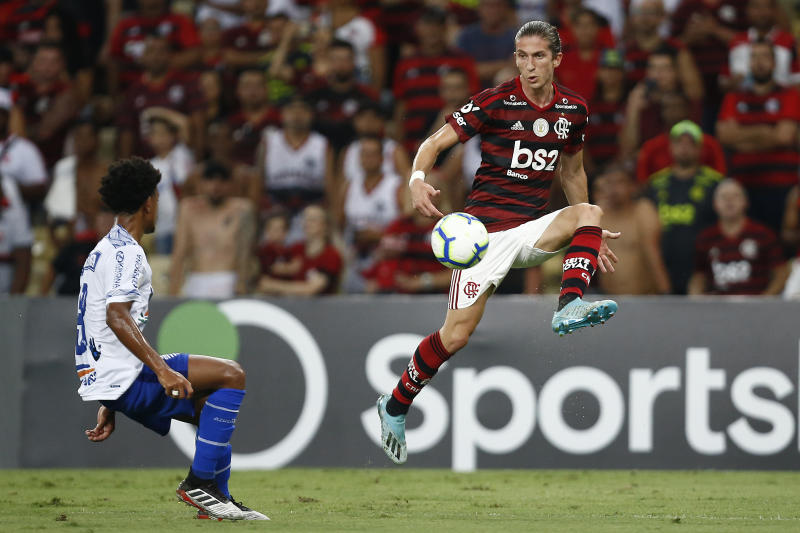 RIO DE JANEIRO, BRAZIL - OCTOBER 27: Warley of CSA competes for the ball with Filipe Luis of FLamengo at Maracana Stadium on October 27, 2019 in Rio de Janeiro, Brazil. (Photo by Wagner Meier/Getty Images)