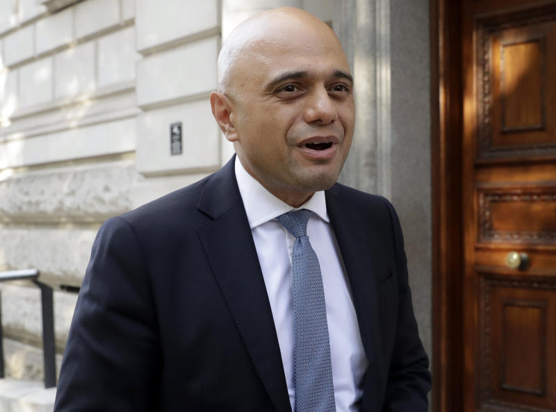 Britain's new Chancellor Sajid Javid speaks to the media as he arrives at the treasury in London, Wednesday, July 24, 2019. British Prime Minister Boris Johnson has appointed Sajid Javid the country's new Treasury chief, one of the most senior jobs in Cabinet. Javid will be responsible for spending and economic policy in Johnson's government. (AP Photo/Matt Dunham)