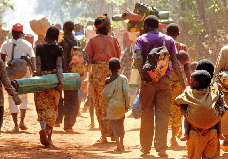 Burundian refugees walk to a camp in Tanzania Ocotber 7 as their home nation faces fresh unrest, which the UN Security Council moved to address with a resolution November 12, 2015