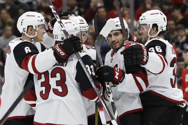 Arizona Coyotes right wing Christian Fischer, right, celebrates with teammates after scoring his goal against the Chicago Blackhawks during the first period of an NHL hockey game Sunday, Dec. 8, 2019, in Chicago. (AP Photo/Nam Y. Huh)