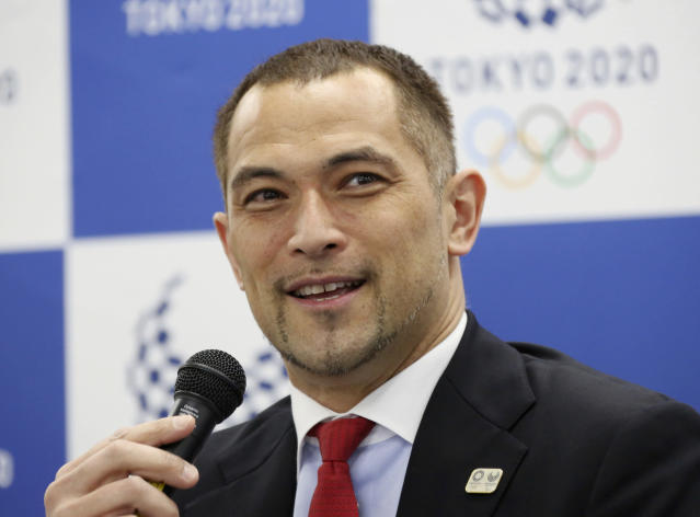 Tokyo 2020 Sports Director Koji Murofushi speaks during a press conference to unveil detailed Olympic competition schedule in Tokyo, Tuesday, April 16, 2019. For fans, athletes, and volunteers in Japan, next years Olympics in Tokyo could become known as the get-up-early games.Organizers announced Tuesday that - hoping to beat summer heat in the Japanese capital - the mens 50-meter race walk final will begin at 5:30 a.m. The mens and womens marathon final will start at 6 a.m. (AP Photo/Koji Sasahara)