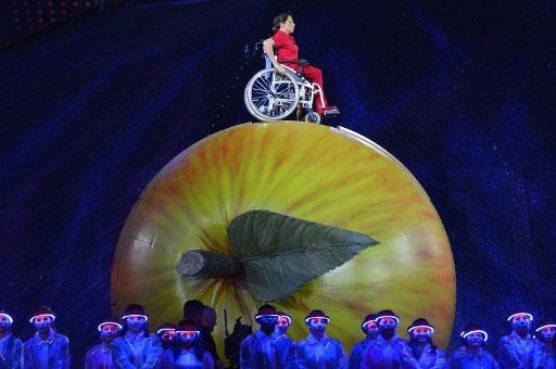 Artists perform during the opening ceremony of the London 2012 Paralympic Games at the Olympic Stadium in east London on August 29, 2012. AFP PHOTO / LEON NEAL