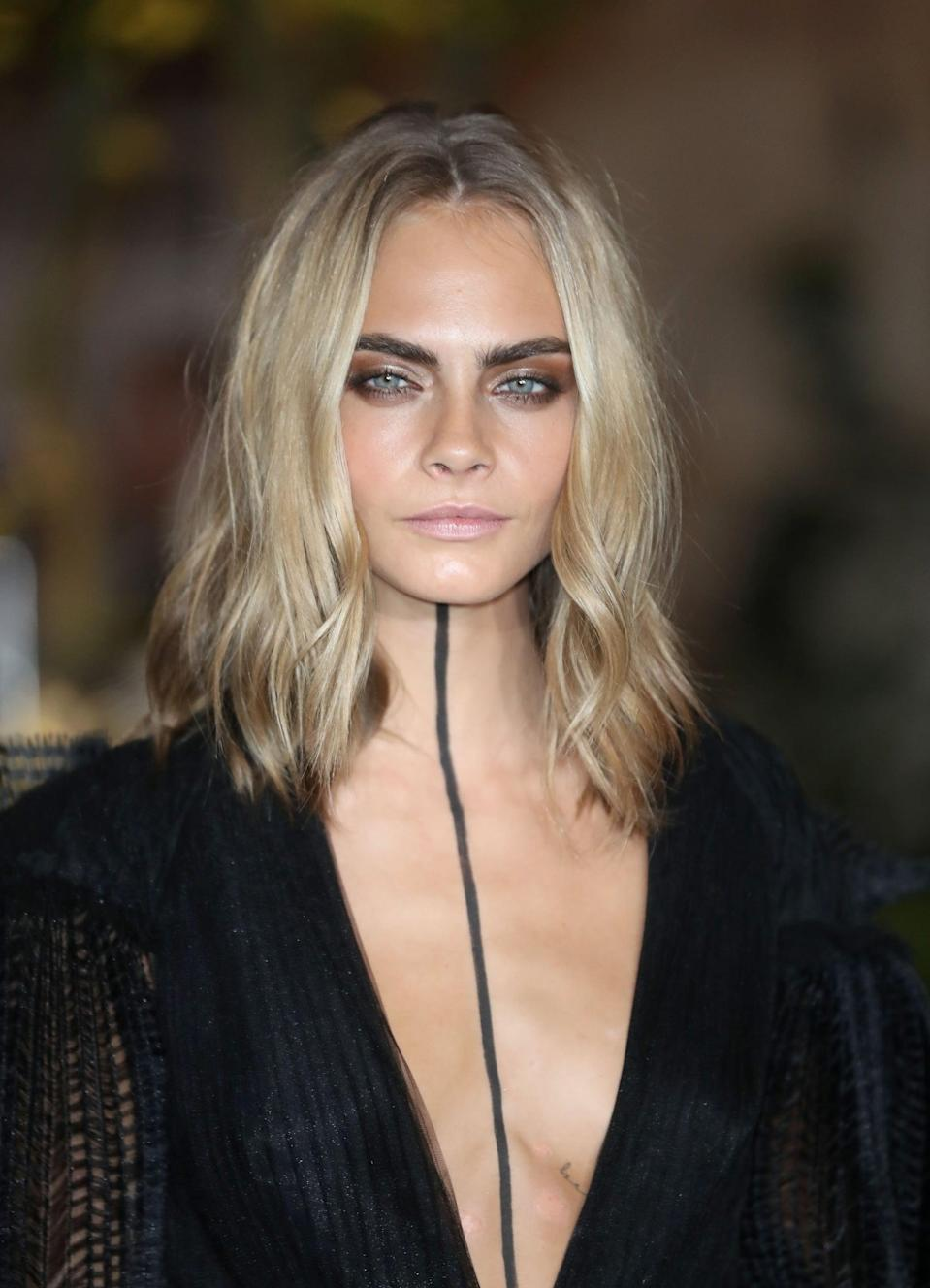 <p>If you're thinking about dyeing your hair dark for Winter months, let Delevingne's cool-toned shade of blond from September 2016 convince you otherwise. The pale hue is a great way to go lighter without washing out your skin in the process.</p>