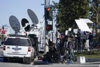 Members of the media stand outside Harbor-UCLA Medical Center Wednesday, Feb. 24, 2021, in Torrance, Calif. Golfer Tiger Woods was hospitalized and underwent surgery at the hospital following a car accident on Tuesday. (AP Photo/Ashley Landis)