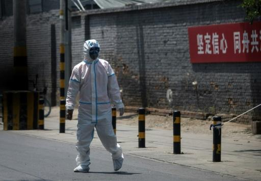 Around 30 residential compounds are under lockdown in Beijing to try and control the spread of the virus