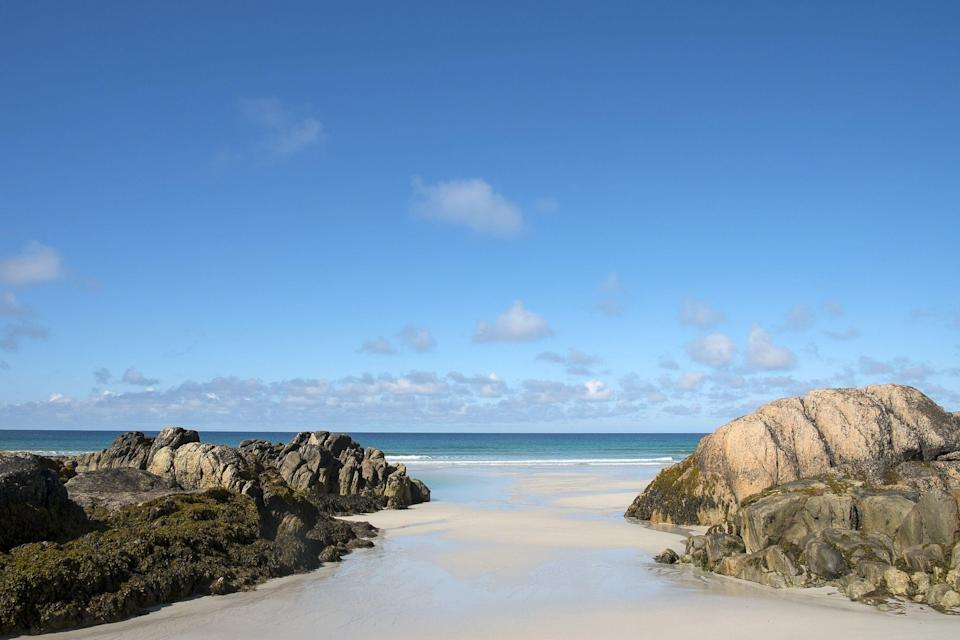 """<p>It might not be the first place you think of in the UK for a <a href=""""https://www.visitscotland.com/see-do/landscapes-nature/beaches/"""" rel=""""nofollow noopener"""" target=""""_blank"""" data-ylk=""""slk:seaside escape"""" class=""""link rapid-noclick-resp"""">seaside escape</a> but the best beaches in Scotland boast sands as soft as icing sugar, turquoise waters and wild backdrops that make for an excellent trip to the coast.</p><p>In fact, if you're after <a href=""""https://www.countryliving.com/uk/wildlife/countryside/g101/best-british-sandy-beaches/"""" rel=""""nofollow noopener"""" target=""""_blank"""" data-ylk=""""slk:sandy beaches"""" class=""""link rapid-noclick-resp"""">sandy beaches</a>, Scotland has plenty to explore, from the hidden gem that is Hackley Bay in Aberdeenshire to the Caribbean-like stretches of the isle of Tiree in the <a href=""""https://www.countrylivingholidays.com/tours/scotland-hebrides-islands-islay-mull-cruise"""" rel=""""nofollow noopener"""" target=""""_blank"""" data-ylk=""""slk:Inner Hebrides"""" class=""""link rapid-noclick-resp"""">Inner Hebrides</a>.</p><p>You'll find hidden coves, surfers' paradises, city beaches and remote shores that seem to stretch for miles - a break on Scotland's coastline offers something for everyone.</p><p>With the UK open for travel and restrictions on entering the country, we practically have Britain to ourselves and a trip to one of Scotland's best beaches is the perfect <a href=""""https://www.countryliving.com/uk/travel-ideas/staycation-uk/g34614070/scotland-staycation/"""" rel=""""nofollow noopener"""" target=""""_blank"""" data-ylk=""""slk:staycation"""" class=""""link rapid-noclick-resp"""">staycation</a> idea for summer.</p><p>You could combine your trip to the beach with visits to pretty villages or lively days out in the city or experience fully immersing yourself in Scotland's nature and wildlife on a secluded escape. Another way to see Scotland's glorious coastline is by hopping from island to island, with various cruises available, such as Country Living's <a href=""""https://www.countrylivingholid"""