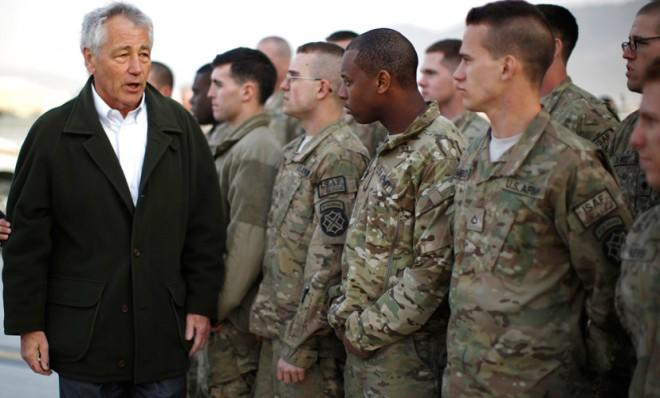 Secretary of Defense Chuck Hagel greets U.S. Army troops on the tarmac of Kabul airport on March 11.