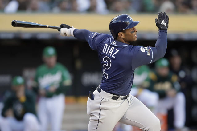 Tampa Bay Rays' Yandy Diaz watches his solo home run against the Oakland Athletics during the third inning of an American League wild-card baseball game in Oakland, Calif., Wednesday, Oct. 2, 2019. (AP Photo/Ben Margot)