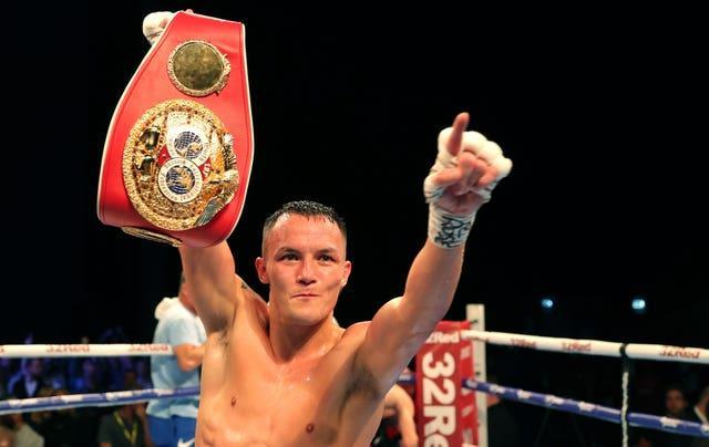Josh Warrington celebrates with the IBF world featherweight title