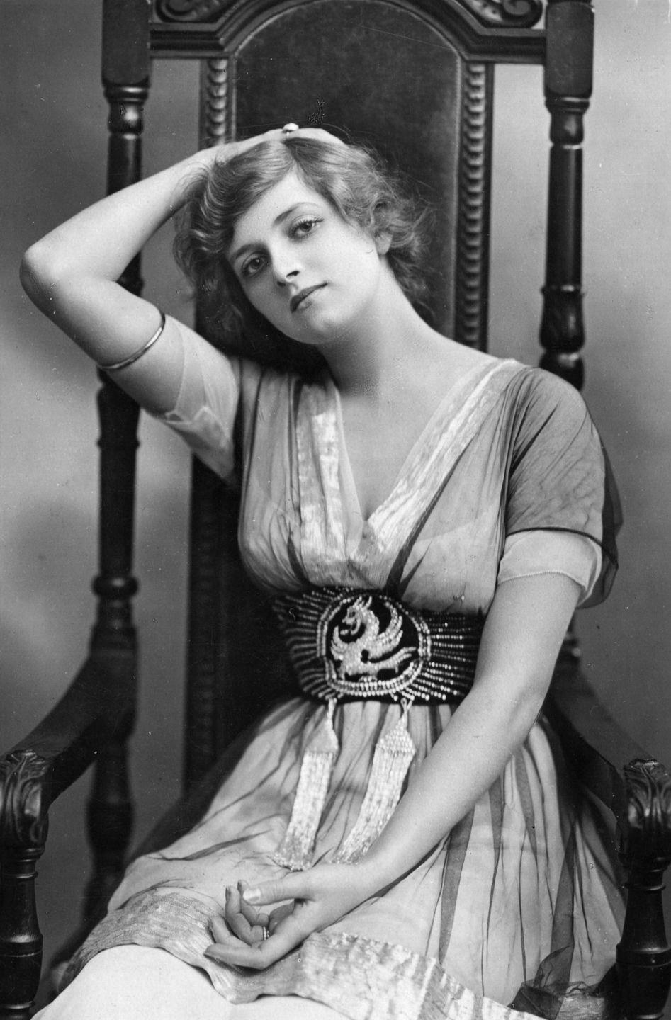 <p>Cooper began her illustrious acting career on the stage, and she starred in the lead role as Pamela in <em>The Pursuit of Pamela </em>in 1913. The actress was queen of accessories, donning a gold arm cuff and embroidered belt at the waist. </p>