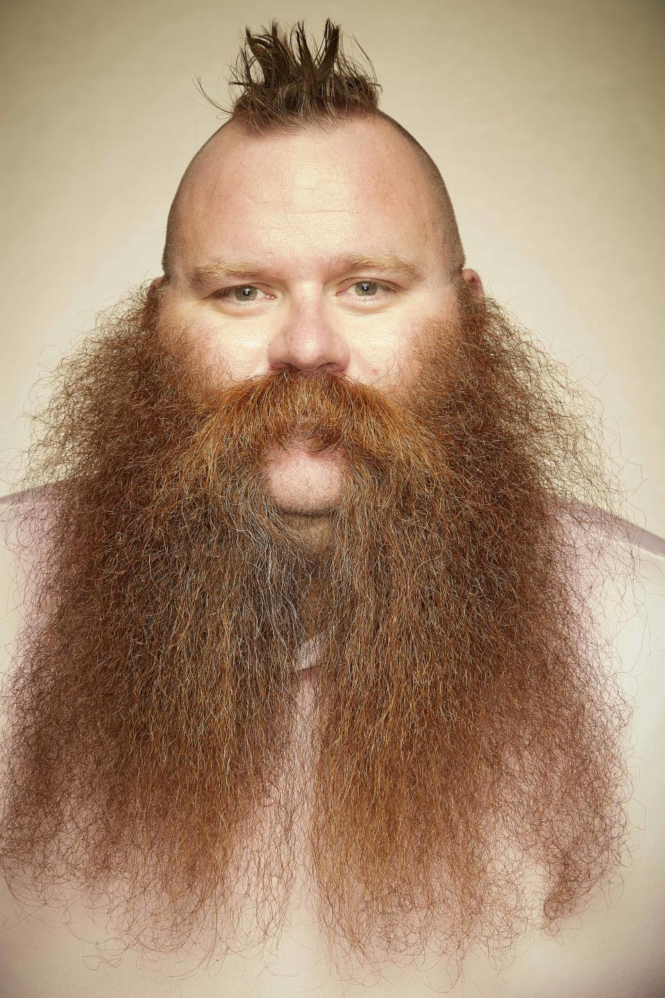 This man is proudly showcasing his ginger lengths. [Photo: Caters]