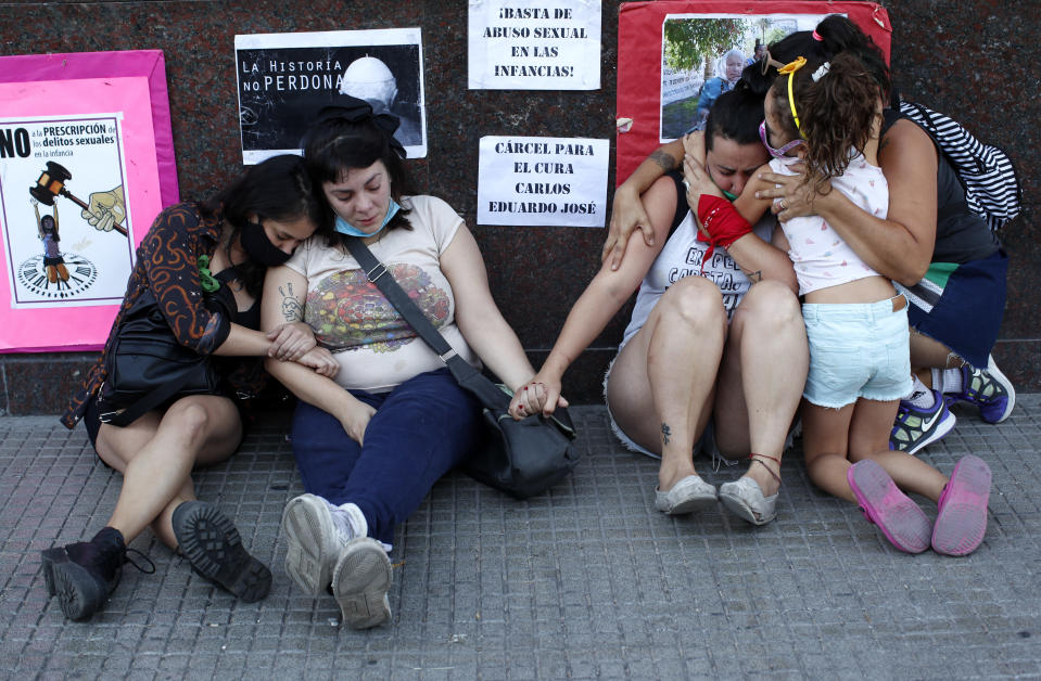 Women embrace outside the courtroom after a judge acquitted former Catholic Priest Carlos Eduardo Jose, citing the statute of limitations had run out on allegations of years of sexual abuse of Mailin Gobbo when she was an adolescent, in San Martin, Argentina, Tuesday, March 9, 2021. (AP Photo/Natacha Pisarenko)