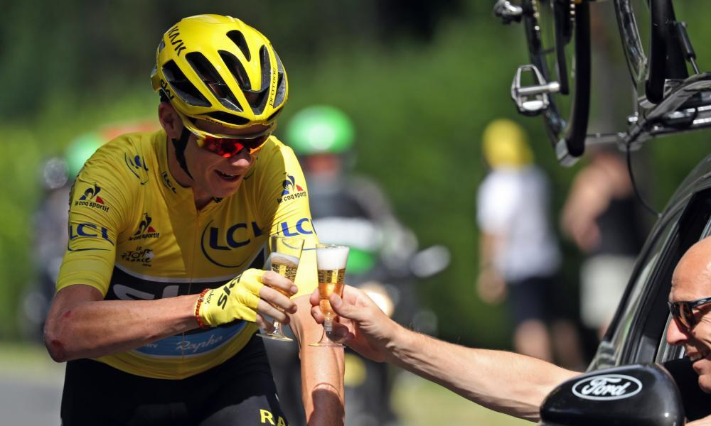 Chris Froome shares a glass of champagne with Team Sky's Sir Dave Brailsford on his way to sealing his fourth victory in the Tour de France.