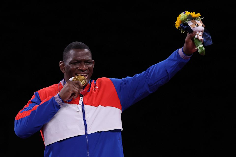 Gold medalist Cuba's Mijain Lopez Nunez poses on the podium after the men's greco-roman 130kg wrestling competition of the Tokyo 2020 Olympic Games at the Makuhari Messe in Tokyo on August 2, 2021. (Photo by Jack GUEZ / AFP) (Photo by JACK GUEZ/AFP via Getty Images)