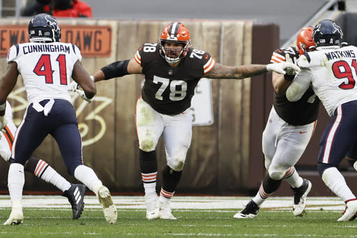 Cleveland Browns offensive tackle Jack Conklin (78) plays against the Houston Texans during the second half of an NFL football game, Sunday, Nov. 15, 2020, in Cleveland. The Cleveland Browns were forced to place three more players, including starting right tackle Jack Conklin and kicker Cody Parkey, on the COVID-19 list Wednesday, Nov. 18, 2020, as they prepare for this week's home game against Philadelphia.(AP Photo/Ron Schwane)