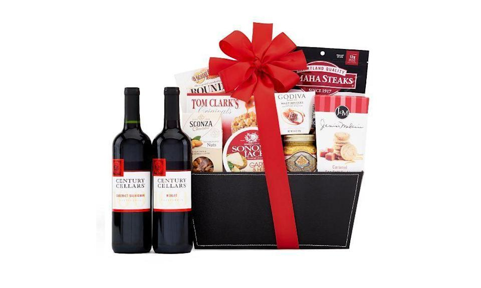 """<p><strong>Century Cellars</strong></p><p>omahasteaks.com</p><p><strong>$84.99</strong></p><p><a href=""""https://go.redirectingat.com?id=74968X1596630&url=https%3A%2F%2Fwww.omahasteaks.com%2Fproduct%2FCentury-Cellars-Duet-Red-Wine-Gift-Basket-06093&sref=https%3A%2F%2Fwww.townandcountrymag.com%2Fleisure%2Fdining%2Fg29328884%2Fbest-wine-cheese-gift-baskets%2F"""" rel=""""nofollow noopener"""" target=""""_blank"""" data-ylk=""""slk:Shop Now"""" class=""""link rapid-noclick-resp"""">Shop Now</a></p><p>Add a little extra protein to the mix with this basket which not only includes a cabernet sauvignon and a merlot, but also peppercorn steak bite, garlic and herb cheese, nits, crackers, popcorn, cookies, and more. </p>"""