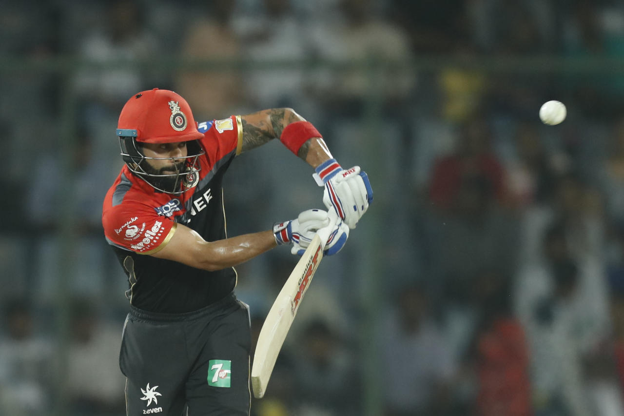 FILE- In this Sunday, May 14, 2017 file photo, Royal Challengers Bangalore's Virat Kohli plays a shot during the Indian Premier League (IPL) cricket match against Delhi Daredevils in New Delhi, India. (AP Photo/Tsering Topgyal, File)