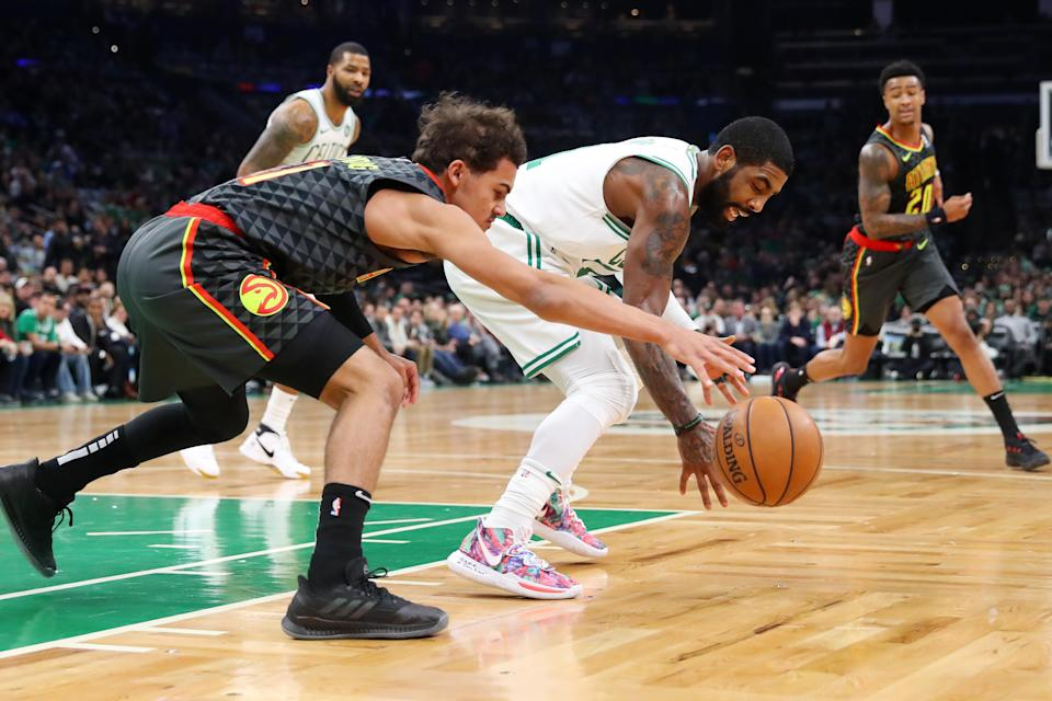 BOSTON, MA - DECEMBER 14: Kyrie Irving #11 of the Boston Celtics steals a loose ball from Trae Young #11 of the Atlanta Hawks during the first quarter at TD Garden on December 14, 2018 in Boston, Massachusetts. (Photo by Maddie Meyer/Getty Images)