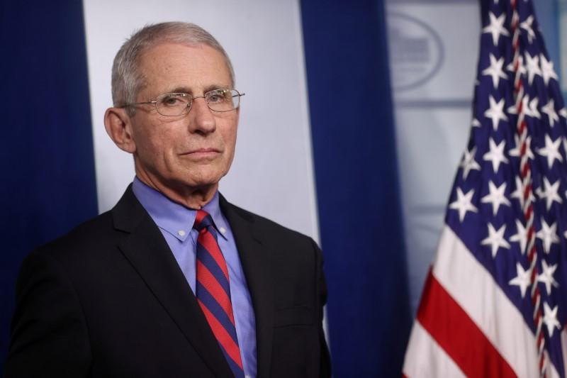 FILE PHOTO: Dr. Anthony Fauci listens to daily coronavirus briefing at the White House in Washington