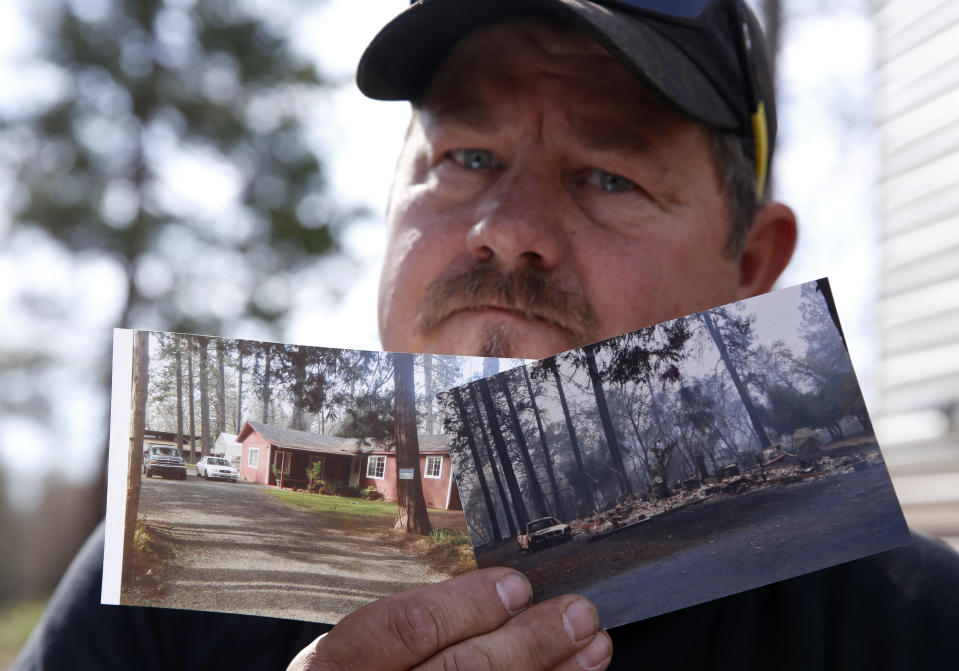 In this Thursday Oct. 24, 2019, photo, Bill Husa displays before-and-after photos of his home lost in last year's Camp Fire in Paradise, Calif. Husa's home is one of nearly 9,000 Paradise homes destroyed in the deadliest and most destructive wildfire in California history. (AP Photo/Rich Pedroncelli)