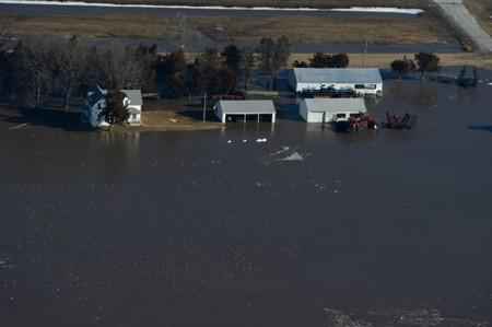 Flooded farm and farm equipment are seen in this aerial photo of the historic flooding conditions in portions of northeast Nebraska