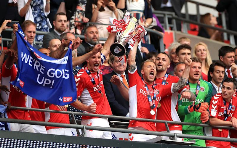 Charlton lift the League One play-off trophy after Patrick Bauer's dramatic late winner gives Sunderland no time to reply - PA