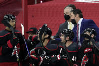Carolina Hurricanes' head coach Rod Brind'Amour, right, directs the team during the first period of an NHL hockey game against the Detroit Red Wings in Raleigh, N.C., on Thursday, March 4, 2021. (AP Photo/Chris Seward)
