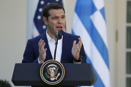 Greek Prime Minister Tsipras speaks as he holds a joint news conference with U.S. President Trump at the White House in Washington