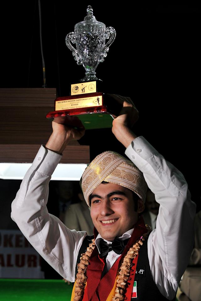 Iran's Hossein Vafaei Ayouri poses with the trophy while wearing the traditional 'Mysooru Peta' (Mysore Turban) after winning the IBSF World Snooker Championship in Bangalore on December 03, 2011. Hossein Lee Walker of Wales by 10 frames to nine. AFP PHOTO/Manjunath KIRAN (Photo credit should read Manjunath Kiran/AFP/Getty Images)