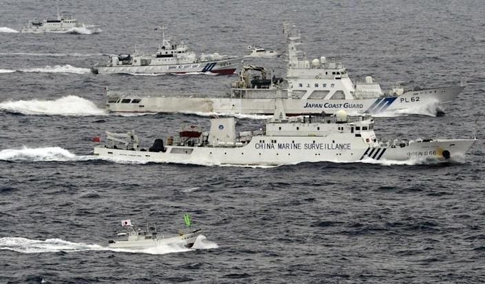 An aerial photo shows a Chinese marine surveillance ship Haijian No. 66 (C) cruising next to Japan Coast Guard patrol ships in the East China Sea, near what are known as the Senkaku isles in Japan and the Diaoyu islands in China, in this photo taken by Kyodo April 23, 2013. REUTERS/Kyodo