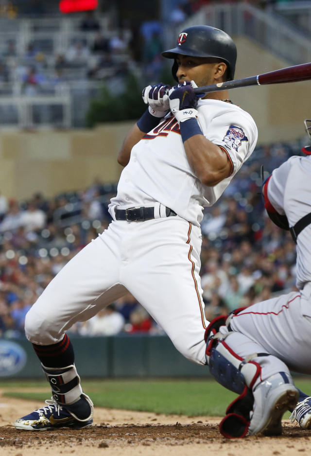Minnesota Twins' Eddie Rosario leans back to avoid a close pitch from Boston Red Sox pitcher Chris Sale during the fourth inning of a baseball game Tuesday, June 19, 2018, in Minneapolis. (AP Photo/Jim Mone)