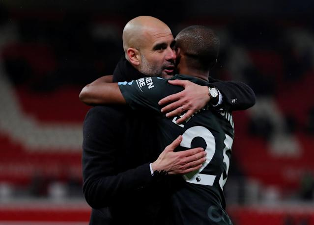 "Soccer Football - Premier League - Stoke City vs Manchester City - bet365 Stadium, Stoke-on-Trent, Britain - March 12, 2018 Manchester City manager Pep Guardiola celebrates with Fernandinho after the match Action Images via Reuters/Andrew Couldridge EDITORIAL USE ONLY. No use with unauthorized audio, video, data, fixture lists, club/league logos or ""live"" services. Online in-match use limited to 75 images, no video emulation. No use in betting, games or single club/league/player publications. Please contact your account representative for further details."