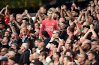 Manchester United fans held up a cardboard cut out of Cristiano Ronaldo in a 1-0 win at Wolves (AFP/Oli SCARFF)