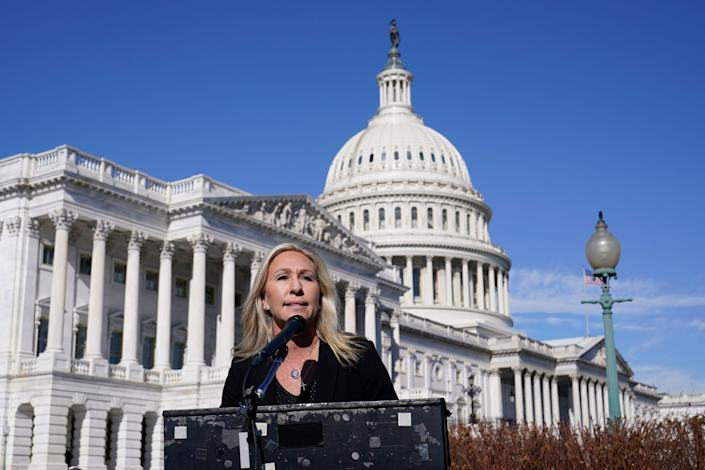 Rep. Marjorie Taylor Greene, R-Ga., speaks during a news conference on Capitol Hill in February.