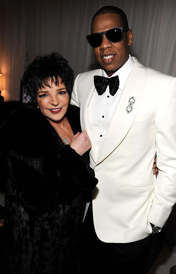"Now there's a duo you don't see every day! Legendary singer and actress Liza Minnelli posed backstage at New York's Carnegie Hall with hip-hop mogul Jay-Z on Monday night. Jay-Z and other singers, including Alicia Keys, performed with a 30-piece orchestra as part of a benefit concert for the United Way and the Shawn Carter foundation. Liza served as the evening's emcee. ""I'd like to give a special shout-out to Liza Minnelli in the house tonight,"" the new dad said while on stage. (2/6/2012)"