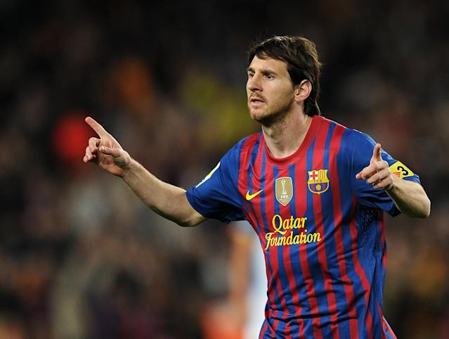 Barcelona's Argentinian forward Lionel Messi celebrates after scoring a goal during the Spanish league football match FC Barcelona vs RCD Espanyol on May 5, 2012 at the Camp Nou stadium in Barcelona. AFP PHOTO/LLUIS GENELLUIS GENE/AFP/GettyImages