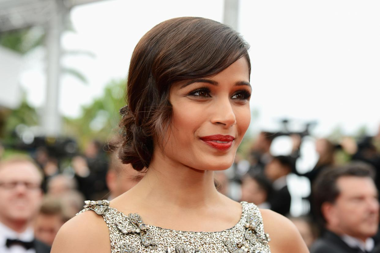 CANNES, FRANCE - MAY 16:  Actress Frieda Pinto attends the 'Jeune & Jolie' premiere during The 66th Annual Cannes Film Festival at the  Palais des Festivals on May 16, 2013 in Cannes, France.  (Photo by Traverso/L'Oreal/Getty Images)