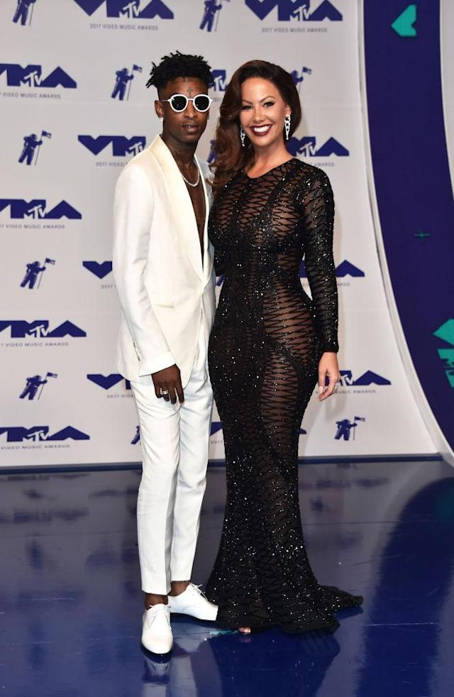<p>Amber Rose appears unrecognizable in an amber wig with boyfriend 21 Savage. (Photo: Getty Images) </p>