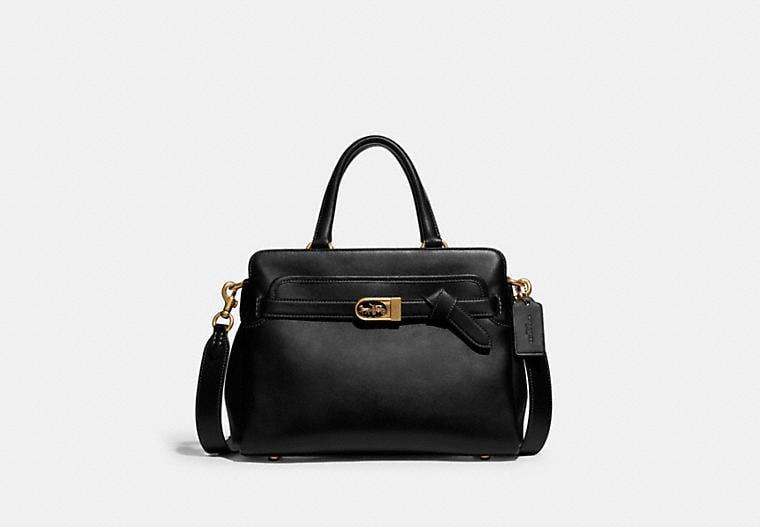 <p>It doesn't get more classic than the chic <span>Coach Tate Carryall 29</span> ($595). The top handle and crossbody strap make it a super-convenient choice as well.</p>
