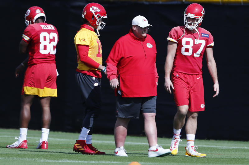Kansas City Chiefs quarterback Patrick Mahomes (15) and tight end Travis Kelce (87) walk with head coach Andy Reid during practice on Thursday, Jan. 30, 2020, in Davie, Fla., for the NFL Super Bowl 54 football game. (AP Photo/Brynn Anderson)