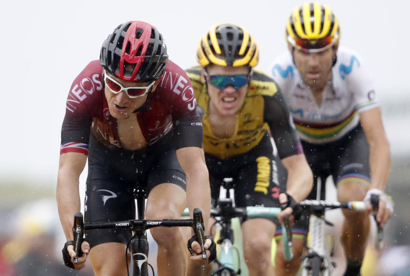 Britain's Geraint Thomas, left, Netherlands' Steven Kruijswijk, center, and Spain's Alejandro Valverde cross the finish line during the fifteenth stage of the Tour de France cycling race over 185 kilometers (114,95 miles) with start in Limoux and finish in Prat d'Albis, France, Sunday, July 21, 2019. (AP Photo/Christophe Ena)