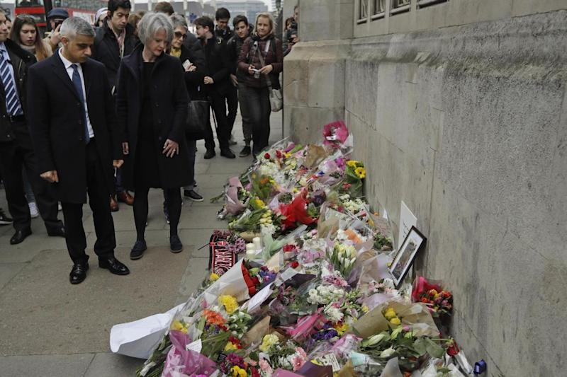 Mayor of London visits tributes layed in Westminster for the four killed and over 50 injured in Wednesday's attack (AP)