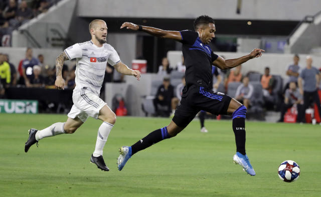 San Jose Earthquakes forward Danny Hoesen, right, dribbles past Los Angeles FC defender Jordan Harvey during the first half of an MLS soccer match Wednesday, Aug. 21, 2019, in Los Angeles. (AP Photo/Marcio Jose Sanchez)