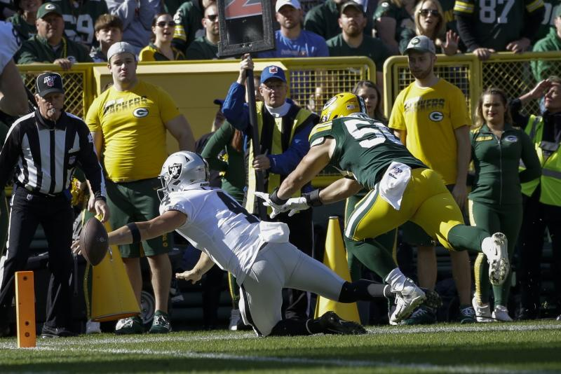 Oakland Raiders' Derek Carr loses the ball as he reaches for the end zone during the first half of an NFL football game against the Green Bay Packers Sunday, Oct. 20, 2019, in Green Bay, Wis. (AP Photo/Jeffrey Phelps)